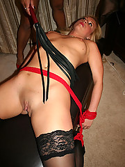 Mistress Maxine X ties her new victim Meagan Diamond spread eagle to the bed