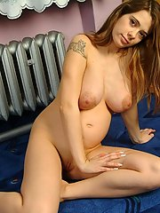 Knocked up Nina strips naked in the nursery