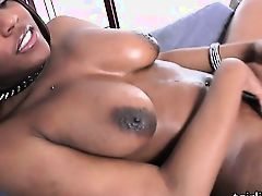 Yummy black tranny Brownie strokes her cock
