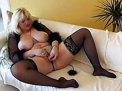 Chubby MILF with big tits dildoing