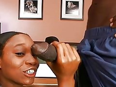 Ebony hottie banged by a big black cock