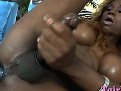 Black tranny with big tits penetrates her ass with big dildo