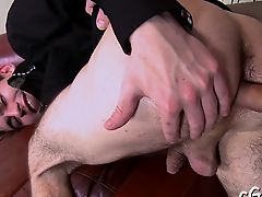 Young man is arousing man with salacious cock engulfing